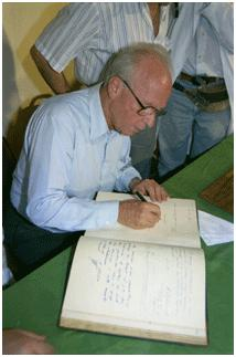 Yitzhak Rabin signing Beilinson Hospital's guest book